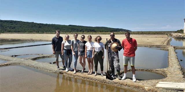 Students of landscape architecture learn the craft of salt making